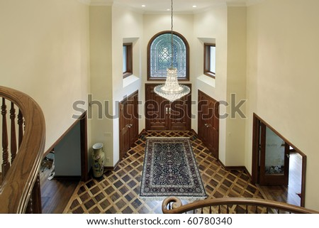 Foyer of luxury home with oval glass window