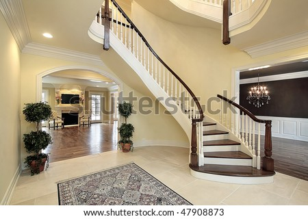 stock photo : Foyer with curved staircase in new construction home
