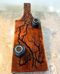 Fractal burned (lightning pattern), cedar board with two sake cups on top, upside down. The board is on top of a light granite surface.
