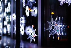 Fractals, snowflakes on the window, neon decorative snowflakes, Christmas window dressing