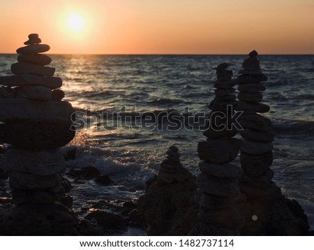 Fragile equilibrium of large and small stones, pyramids of balancing cobbles