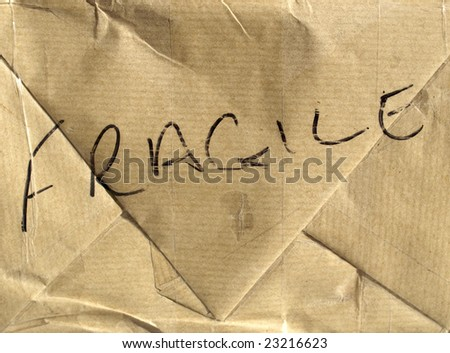Fragile (handle with care) brown corrugated cardboard packet