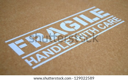 Fragile Handle With Care Sign On A Package