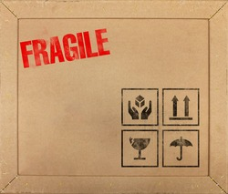 Fragile Travel cardboard box texture with shipping labels