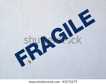 Fragile warning sign on a cardboard box for shipping