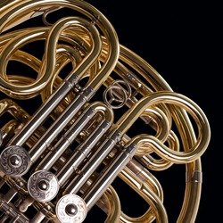 Fragment french horn closeup on a black background
