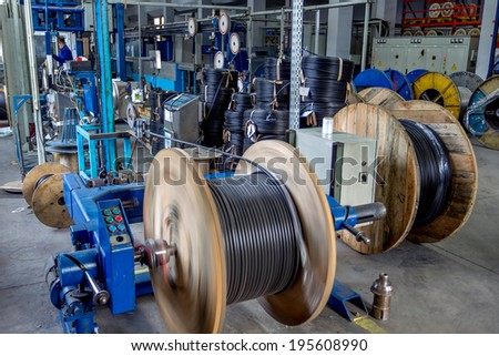 Fragment inside a modern plant producing power electric cables and optical fibers Interior of modern production line technology obsolescence