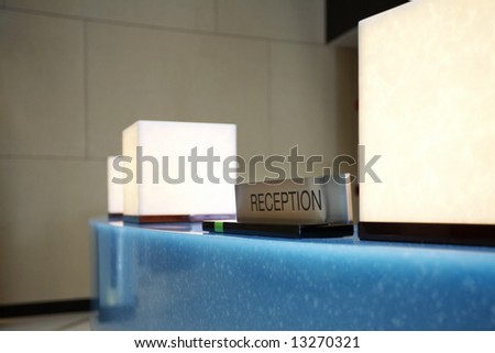 Fragment like shot of reception desk in hotel lobby