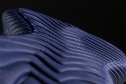 Fragment of a blue sole of a sneaker. The texture of the material of sports shoes