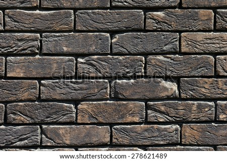 fragment of a brick wall in...