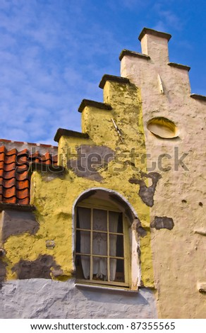 Fragment of a classical dwelling house in Bruges. Belgium. Summer urban landscape. Dutch culture.