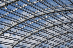 Fragment of a glass roof, transparent roof.