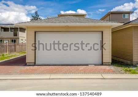 Fragment of a luxury house with a garage door in Vancouver, Canada.