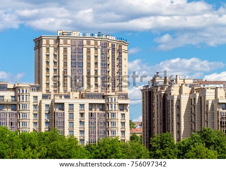 Fragment of a modern high-rise residential building complex. #756097342