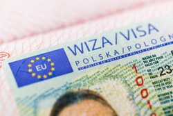 Fragment of a Polish visa in a passport close-up.