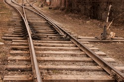 Fragment of a railway track with rails and sleepers in the countryside