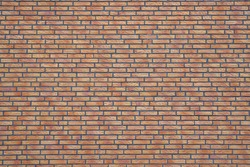 Fragment of a red brick wall for seamles background texture.