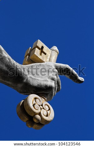 Fragment of a sculpture of apostle Peter - a hand with two keys - established on a St Peter's place in Vatican