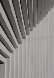 Fragment of a stepped wall of a concrete building in white