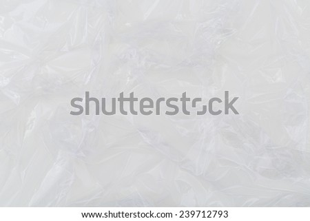 Fragment of a surface covered with multiple layers of a cling polyethylene film as a background texture