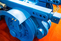 Fragment of a wagon or trailer close-up. Blue trailer from some equipment. Fragment of slipway cart. Manufacture and sale of slipway carts. Concept - equipment for shipbuilding. Cart for transporting