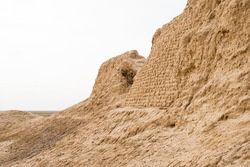 Fragment of an ancient wall. Antique brickwork. Ancient bricks. Ruins of the ancient settlement Sauran. Middle Asia. History of the nomads. Finds of archaeologists. Ancient buildings in the steppe