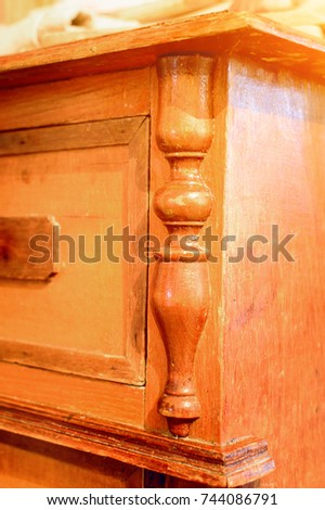 Fragment of an antique antique chest of drawers. #744086791