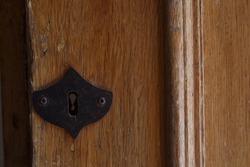 fragment of an old door. fragment of an old door. Rusty keyhole fragment of an old door. Rusty keyhole