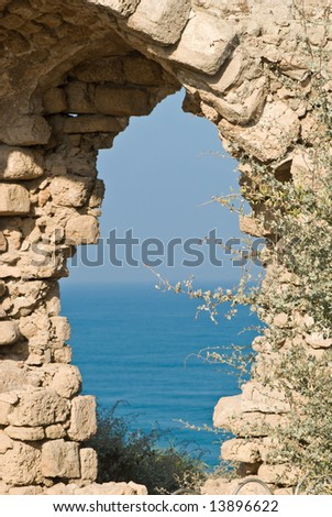 fragment of  ancient arch on the mediterranean sea in Israel