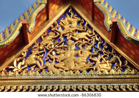 Fragment of ancient carving decorating roof of Buddhist temple in Bangkok, Thailand