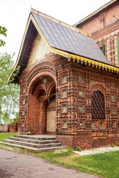 Fragment of architecture, the porch of the Church of the Beheading of John the Baptist in Tolchkovo, unique figured brickwork with tiles. Yaroslavl, Golden Ring of Russia