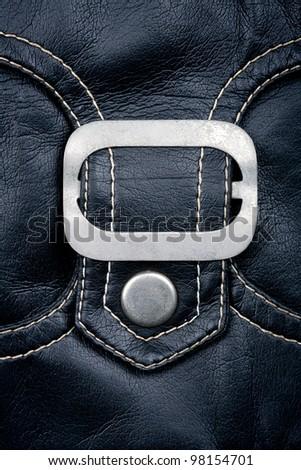 Fragment of black leather jacket  pocket