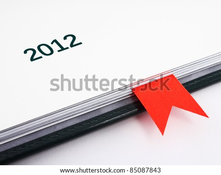 Fragment of business diary on 2012 year with red bookmark in it