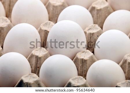 Fragment of carton of fresh eggs