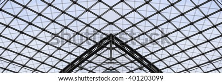 Fragment of ceiling or roof modular supporting structure. Steel and glass contemporary architecture. Structural glazing. Abstract architectural composition with checkered pattern. #401203099