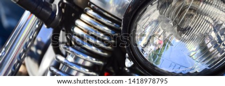 Fragment of chromed shiny lamp of old classic motorbike #1418978795