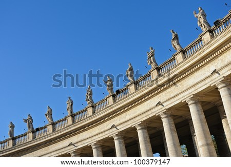 Fragment of colonnade and statues facing St. Peter basilique in Rome, Italy.