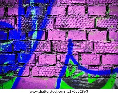 Fragment of concrete wall with graffiti. Fluid smooth glowing dark slate gray, medium blue and bronze multicolor shapes. #1170502963