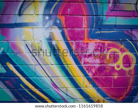 Fragment of concrete wall with graffiti. Fluid smooth glowing steel blue, light steel blue and dark slate gray multicolor shapes. #1161619858