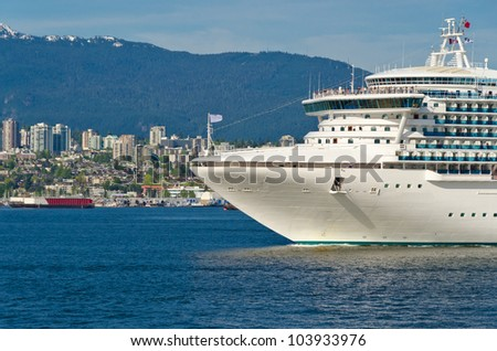 Fragment of cruise ship over snow mountain in the harbour in Vancouver, Canada.