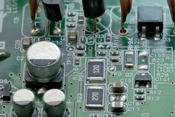 Fragment of electronic microcircuit of modern digital equipment close-up macro photography