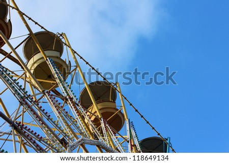 fragment of ferris wheel, on blue sky background