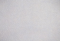 Fragment of genuine cow leather artificially dyed light gray, bright silver color. Background, pattern, texture.