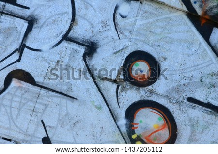 Fragment of graffiti drawings. The old wall decorated with paint stains in the style of street art culture. Colored background texture #1437205112