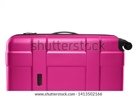 Fragment of gray plastic valise on wheels isolated on white background