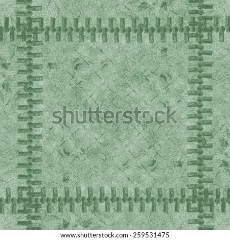 fragment of green ladies handbag imitation snakeskin closeup, zipper