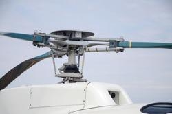 Fragment of helicopter screw engine close up against blue sky. Propeller of the ukrainian heli transporter