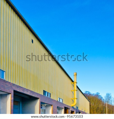Fragment of industrial building with chimney.