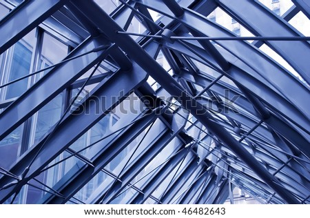 Fragment of modern urban architecture, metal roof of a corridor between office buildings