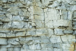 Fragment of natural limestone cliff in Kesselaid (also Kessulaid) islet nordic coast. Tiny island in Suur Strait, Baltic Sea Layers of cracked rocks. Texture of  hard sedimentary rock. Estonian coast.